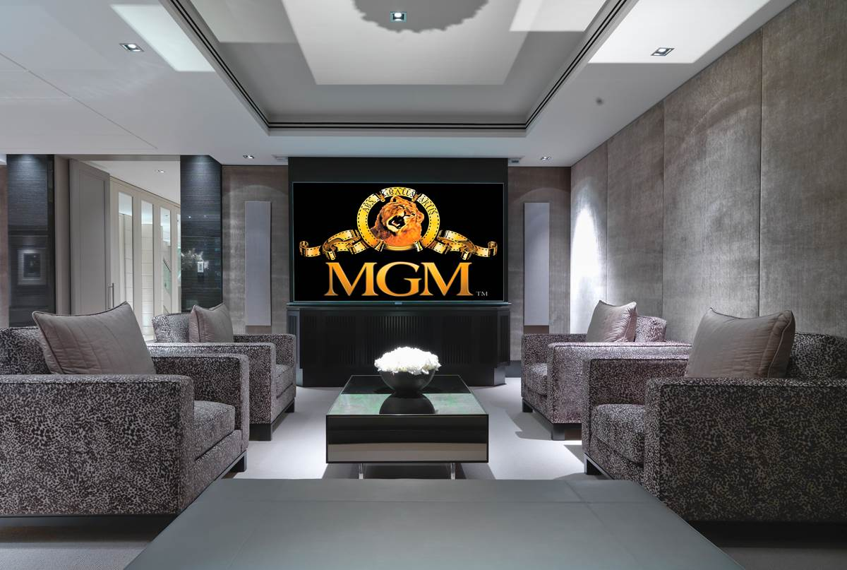 Automated home cinema room with MGM logo featured on large screen