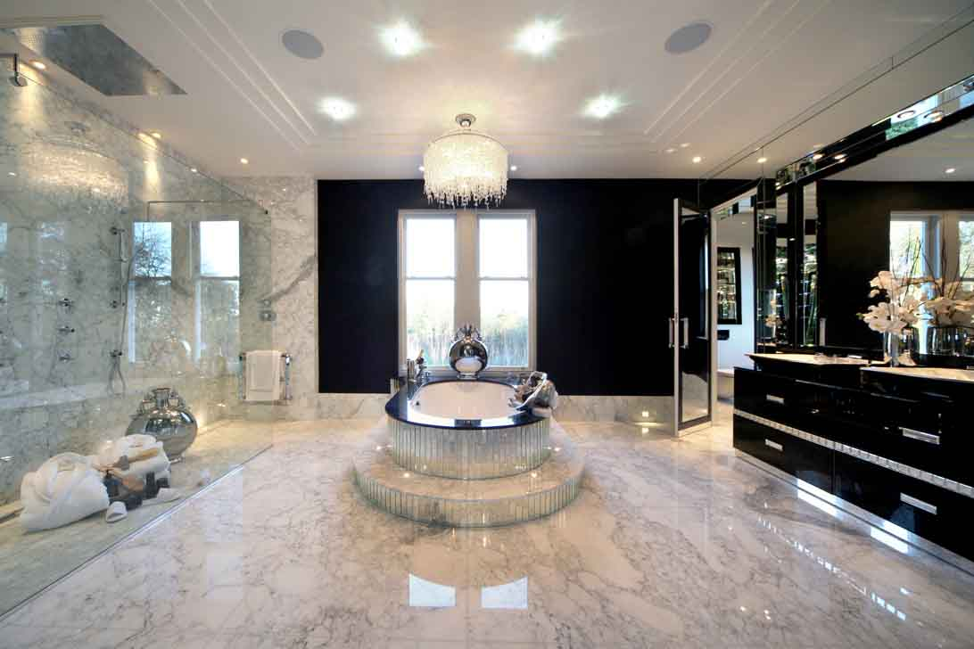 Expansive bathroom space with marbled floor and luxury bath