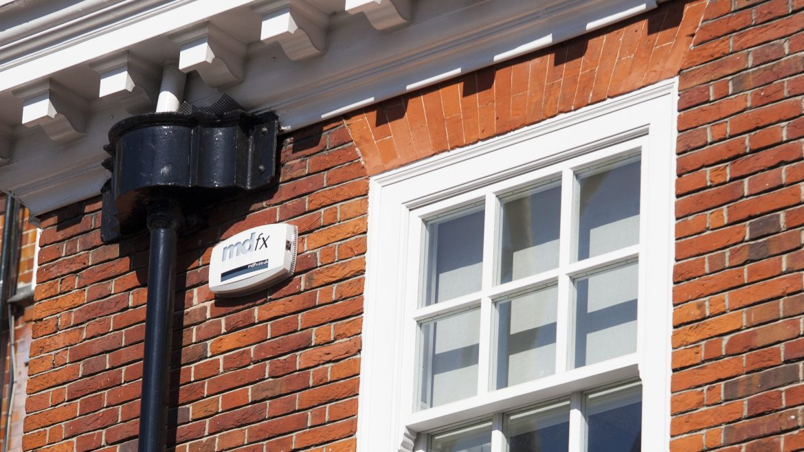 MDfx security alarm system displayed outside home