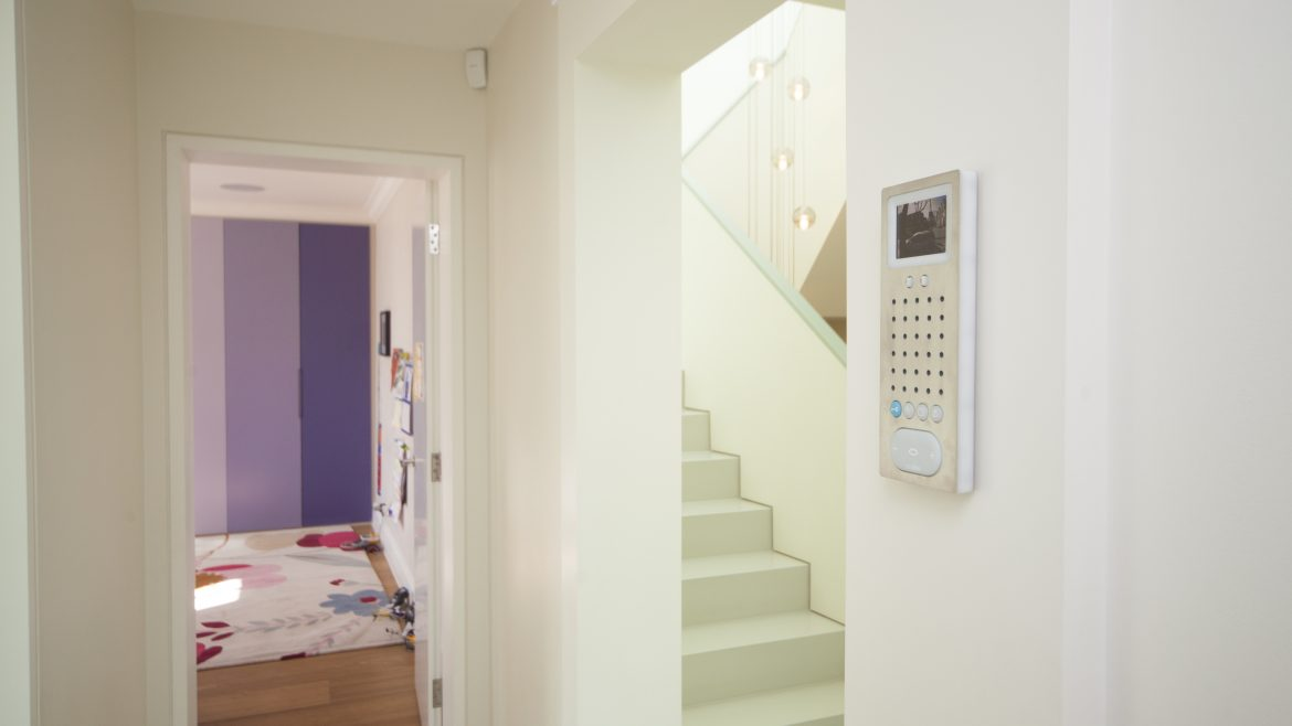 Home intercom and access control system installed to wall in home