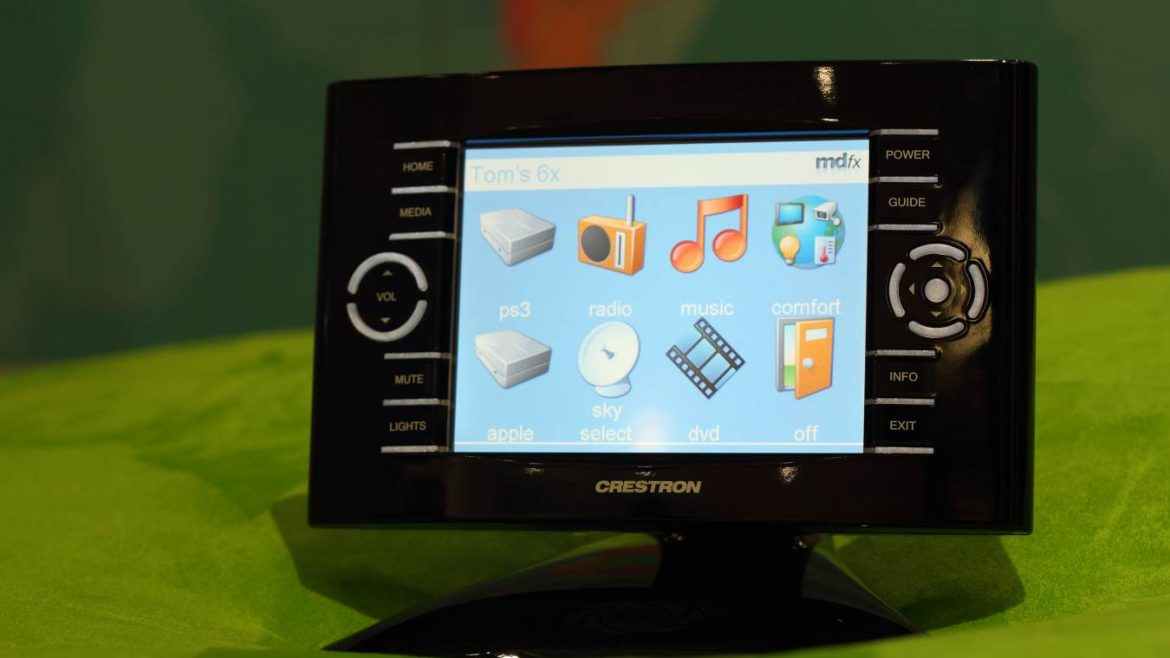 Crestron home automation device in display on green surface