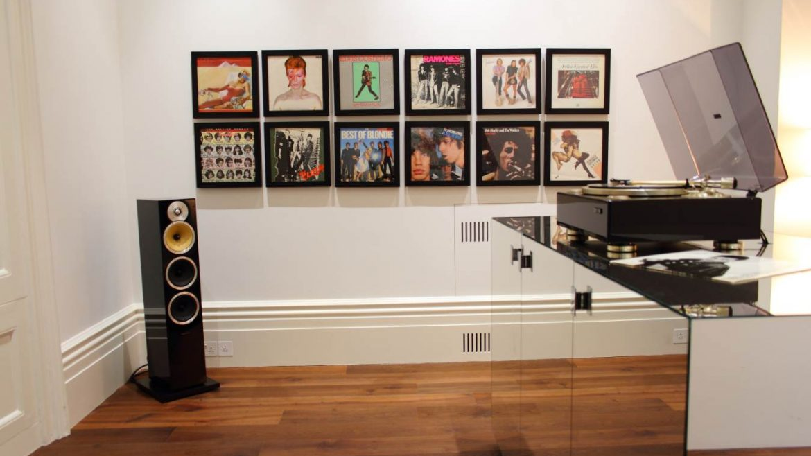 Recreational room featuring hi-fi, record player and cover art on wall