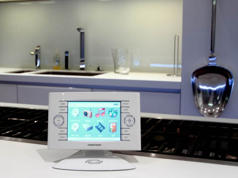 Crestron smart home device on kitchen counter