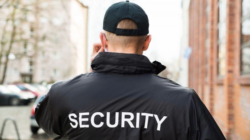 security guard standing while on phone