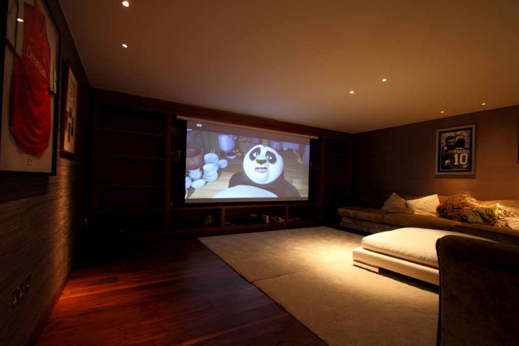 Home Theatre with big projector screen. Family home cinema